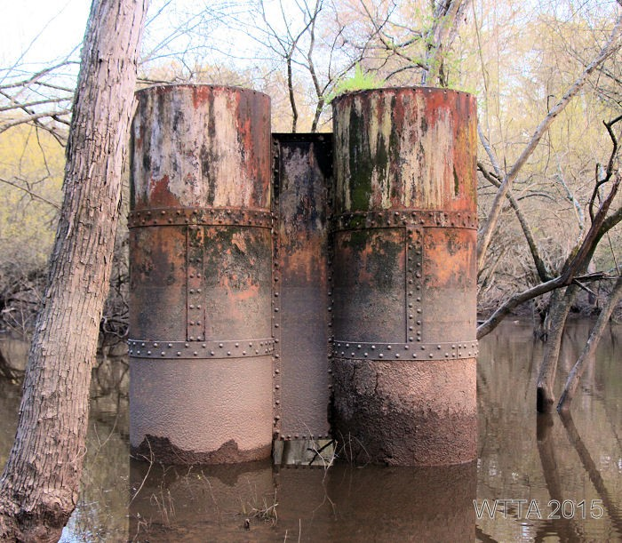 Old metal railroad support beams at Mineola Nature Preserve.