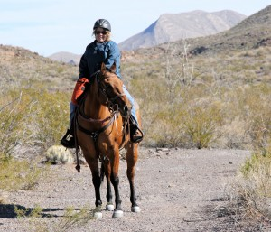 Kelly Brough and Whiskey near Puerta Chilicote trailhead off the Llano Loop.