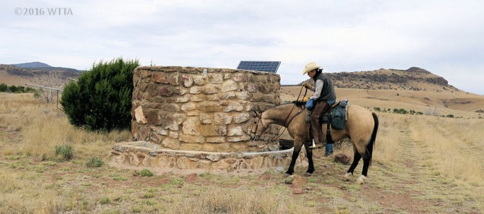Pilar is encouraging Ute to drink from the well.